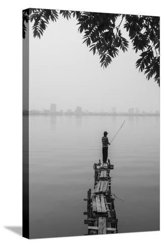 Vietnam, Hanoi. Tay Ho, West Lake, Fisherman-Walter Bibikow-Stretched Canvas Print