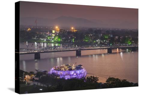 Vietnam, Hue. Trang Tien Bridge and Perfume River, Elevated View, Dusk-Walter Bibikow-Stretched Canvas Print
