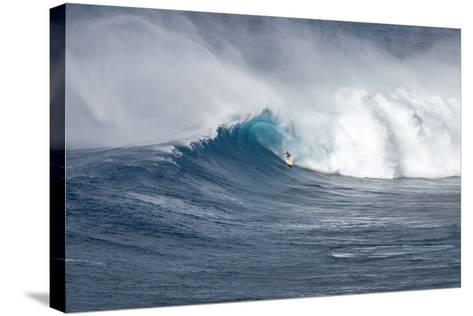 Hawaii Maui. Kyle Lenny Surfing Monster Waves at Pe'Ahi Jaws-Janis Miglavs-Stretched Canvas Print