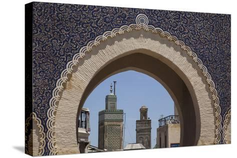Africa, Morocco, Fes. an Arch with Classic Moorish Decor Frames Two Minarets-Brenda Tharp-Stretched Canvas Print
