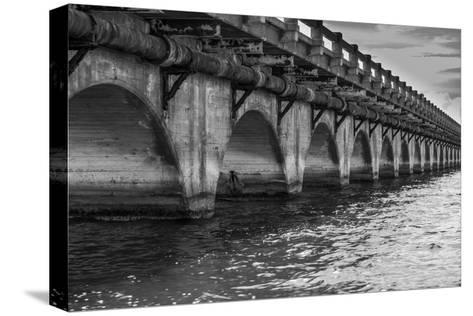 Black and White Horizontal Image of an Old Arch Bridge in Near Ramrod Key, Florida-James White-Stretched Canvas Print