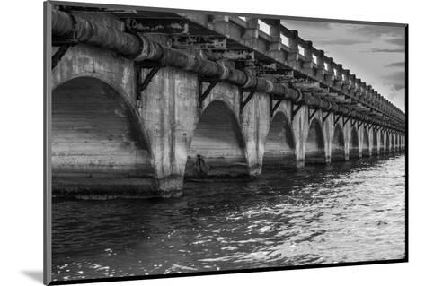 Black and White Horizontal Image of an Old Arch Bridge in Near Ramrod Key, Florida-James White-Mounted Photographic Print