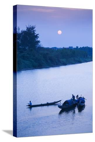 Vietnam, Dmz Area. Dong Ha, Cam Lo River, Boats at Sunset-Walter Bibikow-Stretched Canvas Print