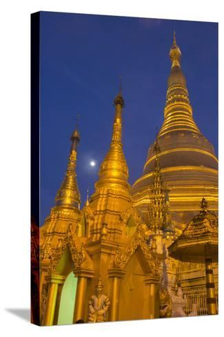 Myanmar, Yangon. Golden Stupa and Temples of Shwedagon Pagoda at Night with Moon-Brenda Tharp-Stretched Canvas Print