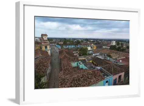 Cuba, Trinidad. Storm Clouds Above the Rooftops of Town-Brenda Tharp-Framed Art Print