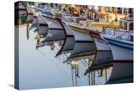 Fishing Boats Reflect in Morning Light in Harbor in Fisherman's Wharf in San Francisco, California-Chuck Haney-Stretched Canvas Print