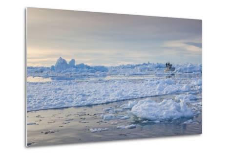 Greenland, Disko Bay, Ilulissat, Fishing Boat in Floating Ice at Sunset-Walter Bibikow-Metal Print