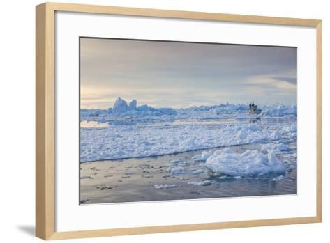 Greenland, Disko Bay, Ilulissat, Fishing Boat in Floating Ice at Sunset-Walter Bibikow-Framed Art Print