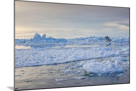 Greenland, Disko Bay, Ilulissat, Fishing Boat in Floating Ice at Sunset-Walter Bibikow-Mounted Photographic Print