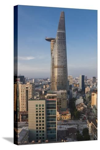 Vietnam, Ho Chi Minh City. Elevated City View with Bitexco Tower, Dawn-Walter Bibikow-Stretched Canvas Print