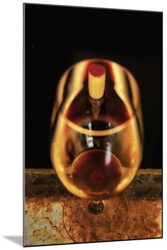 Washington State, Walla Walla. the Illusion of a Bottle Inside a Glass in a Walla Walla Winery-Richard Duval-Mounted Photographic Print