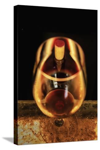 Washington State, Walla Walla. the Illusion of a Bottle Inside a Glass in a Walla Walla Winery-Richard Duval-Stretched Canvas Print
