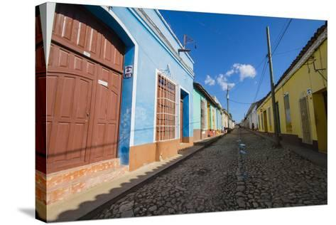 Cuba. Casa Particulares Line the Street, Shown by their Particular Logo Above the Street Number-Inger Hogstrom-Stretched Canvas Print