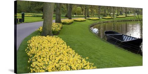 Boat on Keukenhof Gardens Lake in Early Spring-Anna Miller-Stretched Canvas Print