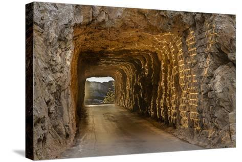 Tunnel on Iron Mountain Road Lit by Setting Sun, Mount Rushmore, South Dakota-Chuck Haney-Stretched Canvas Print