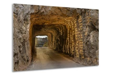 Tunnel on Iron Mountain Road Lit by Setting Sun, Mount Rushmore, South Dakota-Chuck Haney-Metal Print