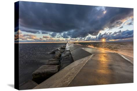 Sunset on the Pier to the Ludington Lighthouse in Lake Michigan in Ludington, Michigan, Usa-Chuck Haney-Stretched Canvas Print