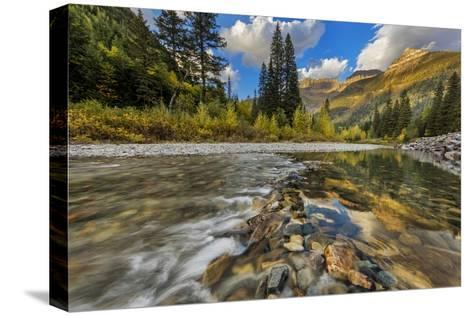 Mcdonald Creek with the Garden Wall in Glacier National Park, Montana, Usa-Chuck Haney-Stretched Canvas Print