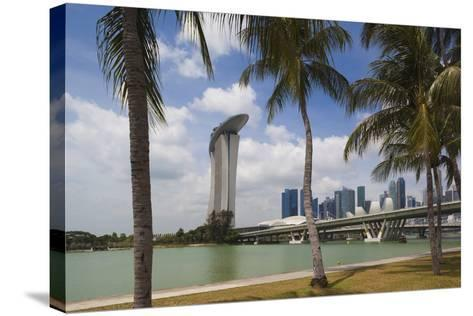 Singapore, City Seen from the Waterfront-Walter Bibikow-Stretched Canvas Print
