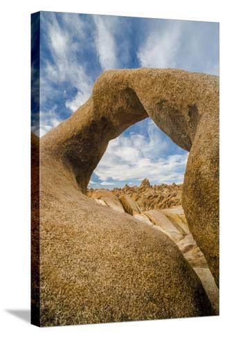 California, Alabama Hills Recreation Area. Mobius Arch with Clouds-Judith Zimmerman-Stretched Canvas Print