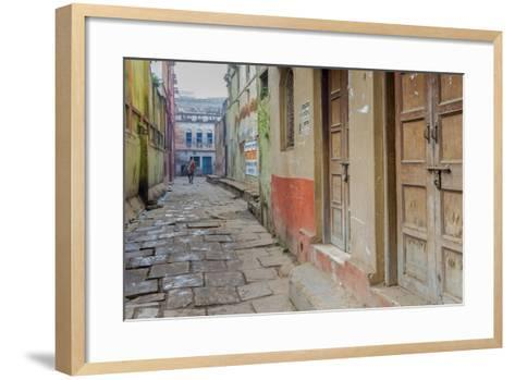 India, Varanasi a Man Walking Down a Stone Tiled Street in the Downtown Area-Ellen Clark-Framed Art Print