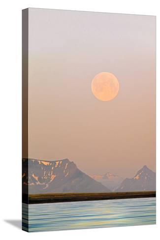 Arctic, Svalbard, Longsfjorden. Moonrise Rises Through Dust at Midnight-David Slater-Stretched Canvas Print