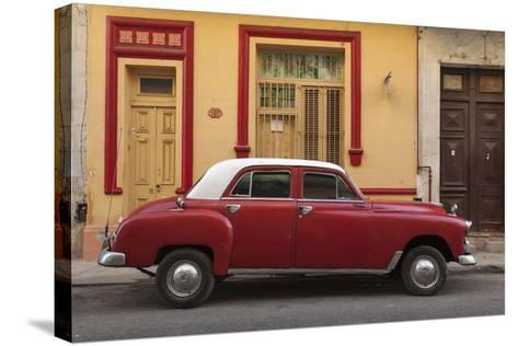 Cuba, Havana. Classic Car Parked on the Street-Brenda Tharp-Stretched Canvas Print