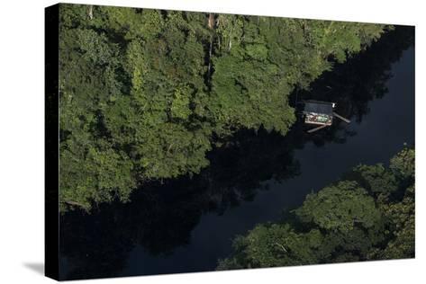 Houseboat on River. Potaro-Siparuni Region. Brazil, Guyana Border, Guyana-Pete Oxford-Stretched Canvas Print