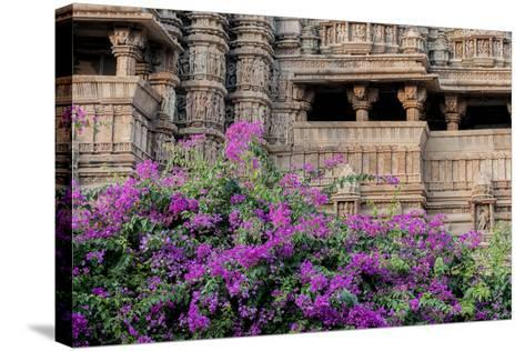 India, Madhya Pradesh State Temple of Kandariya with Bushes of Bougainvillea Flowers in Foreground-Ellen Clark-Stretched Canvas Print