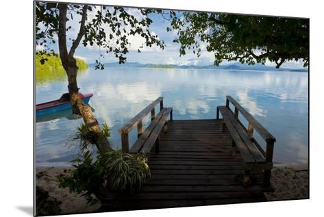 Pier of an Eco Lodge Above the Water of the Marovo Lagoon, Solomon Islands, Pacific-Michael Runkel-Mounted Photographic Print