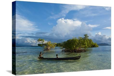 Young Boys Fishing in the Marovo Lagoon before Dramatic Clouds, Solomon Islands, South Pacific-Michael Runkel-Stretched Canvas Print