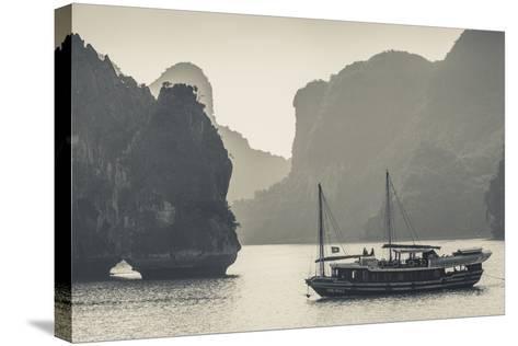 Vietnam, Halong Bay, Boat Traffic-Walter Bibikow-Stretched Canvas Print