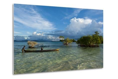 Young Boys Fishing in the Marovo Lagoon before Dramatic Clouds, Solomon Islands, South Pacific-Michael Runkel-Metal Print