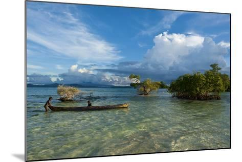 Young Boys Fishing in the Marovo Lagoon before Dramatic Clouds, Solomon Islands, South Pacific-Michael Runkel-Mounted Photographic Print
