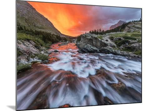 Brilliant Sunrise Sky over Swiftcurrent Falls in Glacier National Park, Montana, Usa-Chuck Haney-Mounted Photographic Print