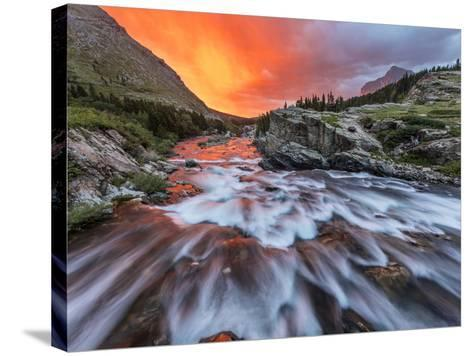 Brilliant Sunrise Sky over Swiftcurrent Falls in Glacier National Park, Montana, Usa-Chuck Haney-Stretched Canvas Print