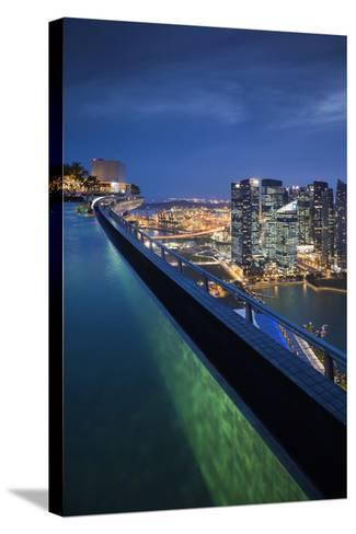 Singapore, Rooftop Swimming Pool at Dusk Overlooks the City-Walter Bibikow-Stretched Canvas Print