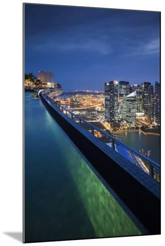 Singapore, Rooftop Swimming Pool at Dusk Overlooks the City-Walter Bibikow-Mounted Photographic Print