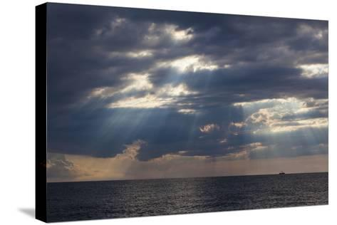 A Fishing Trawler under Storm Clouds at Duck Harbor Beach in Wellfleet, Massachusetts. Cape Cod-Jerry and Marcy Monkman-Stretched Canvas Print