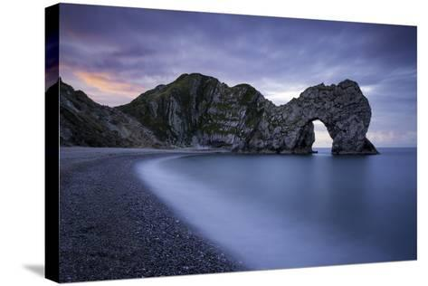 Colorful Sky at Dawn over Durdle Door Along the Jurassic Coast, Dorset, England-Brian Jannsen-Stretched Canvas Print