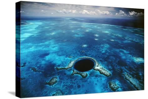An Aerial View of the Blue Hole Off of the Coast of Belize-David Doubilet-Stretched Canvas Print