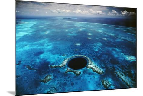 An Aerial View of the Blue Hole Off of the Coast of Belize-David Doubilet-Mounted Photographic Print