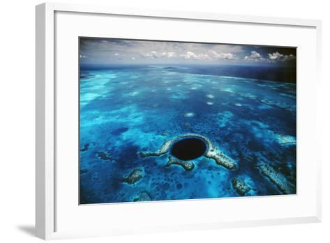 An Aerial View of the Blue Hole Off of the Coast of Belize-David Doubilet-Framed Art Print