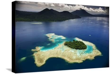 Volcanoes Shrouded in Rain Forest Slope Toward an Island in Kimbe Bay-David Doubilet-Stretched Canvas Print
