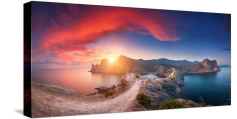 Amazing Summer Landscape with Mountains, Sea, Blue Sky, Sun and Beautiful Colorful Red Clouds-Denys Bilytskyi-Stretched Canvas Print