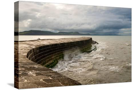 A Stormy Day at the Cobb in Lyme Regis in Dorset, England UK-Tracey Whitefoot-Stretched Canvas Print