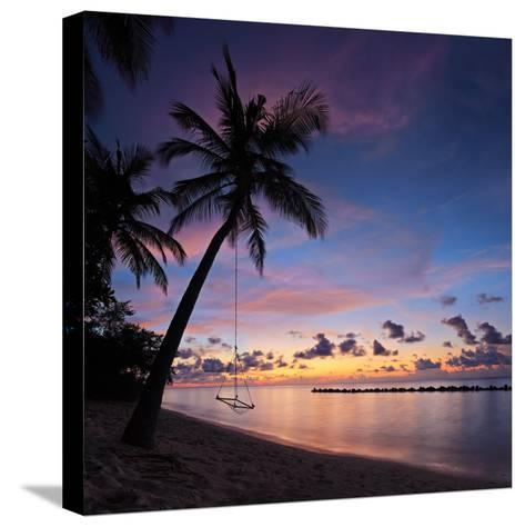 A View of a Beach with Palm Trees and Swing at Sunset, Kuredu Island, Maldives, Lhaviyani Atoll-Ljsphotography-Stretched Canvas Print