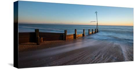 A View of a Groyne at Hayling Island-Chris Button-Stretched Canvas Print