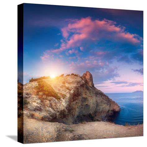 Mountain Landscape with Colorful Blue Sky with Purple Clouds, Sun and Sea at Sunset in Crimea-Denys Bilytskyi-Stretched Canvas Print