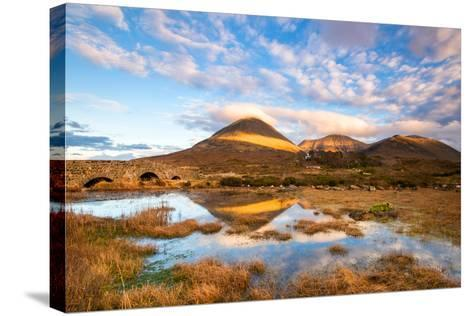 Reflections on a Lochan at Sligachan Bridge on the Isle of Skye, Scotland UK-Tracey Whitefoot-Stretched Canvas Print